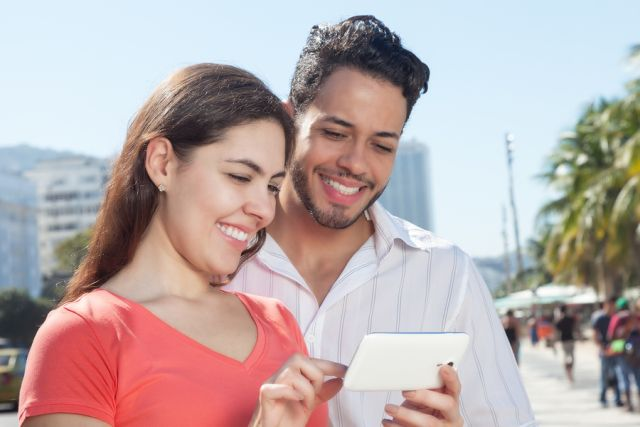 Young Latino Couple Lifeline Phone Service